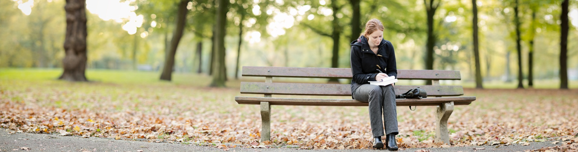 Woman sitting on a park bench